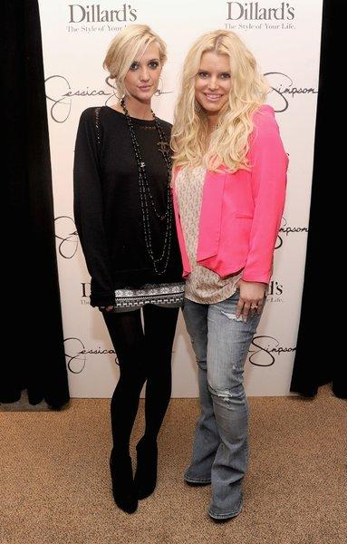 Jessica Simpson, right, with sister Ashley at Dillard's in Tampa, Fla., shows off her 60-pound weight loss.
