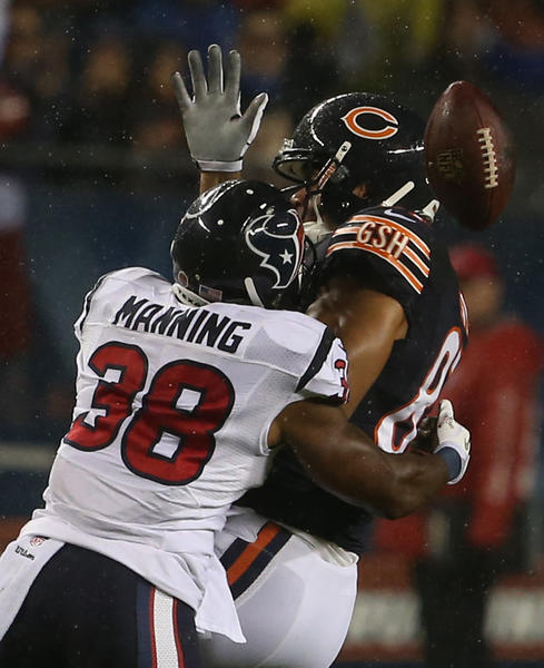 Texans free safety Danieal Manning (38) forces Chicago Bears tight end Kellen Davis (87) to fumble during the first half of their game at Soldier Field on Nov. 11.