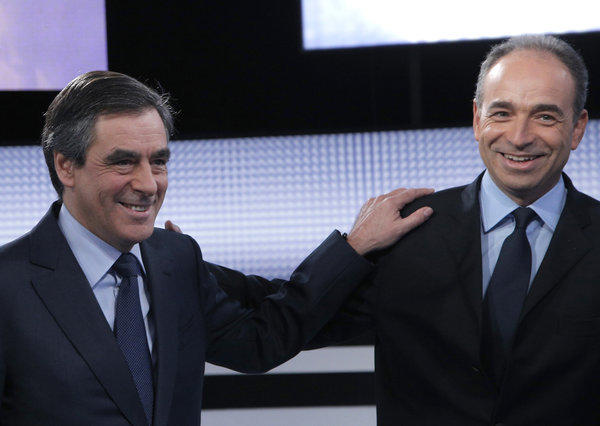 In this Oct. 25 file photo, former French Prime Minister Francois Fillon, left, and French conservative party UMP secretary-general Jean-Francois Cope pose for photographers before a televised debate in Saint Denis, outside Paris.