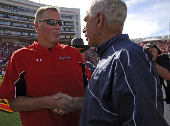 Randy Edsall, left, and Paul Pasqualoni after UConn beat Maryland this season.