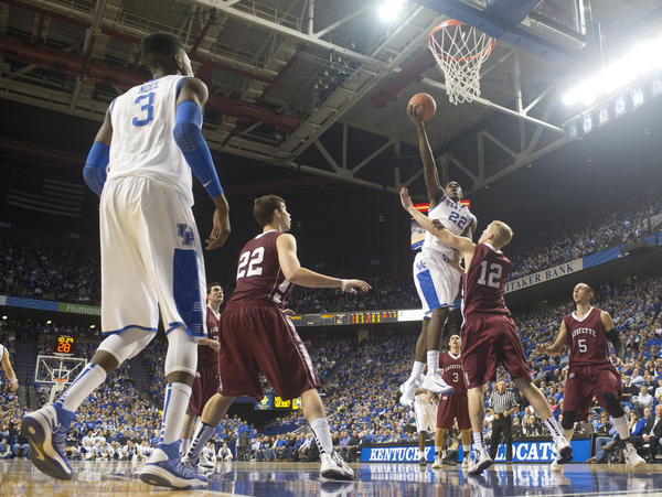 Despite the fact that Alex Poythress (22) leads Kentucky in scoring and rebounding, and is shooting 70 percent from the floor, Kentucky coach John Calipari continues to harp on the play of the freshman forward, who scores above against Lafayette on Friday. Poythress knows Calipari is expecting a lot out of him, and Poythress said he is learning from his coach¿s criticisms.