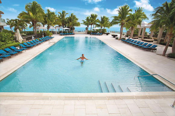 The Residences amenities include a spectacular oceanfront pool deck with lagoon pool, lap pool, two whirlpool spas, a poolside grille and 375 feet of pristine, white-sand beach.
