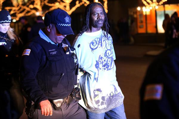 Jimmy Harris, 56, is taken into custody by Chicago Police.