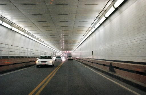 Vehicles travel through the existing Midtown Tunnel