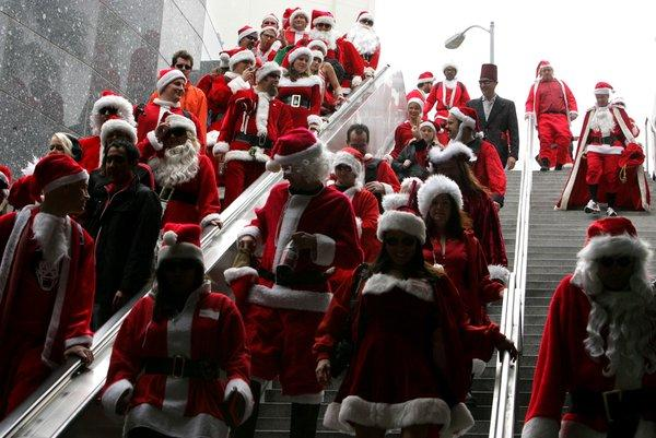 Participants flood into the subway during Santa Con. Could the surge in goodwill at small businesses this season spark a similar scene?