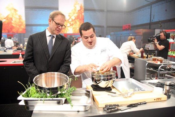 "Alton Brown and Eric Greenspan on Greenspan's previous season of the ""Next Iron Chef."""