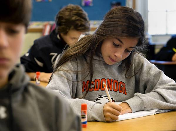 Seventh-grader Lily Stavisky concentrates during math class at the McDonogh School in Owings Mills.