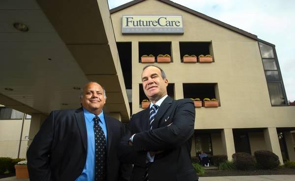 FutureCare senior vice president Jeffery Attman and CEO and President Gary Attman (right) at the company's Canton Harbor facility.