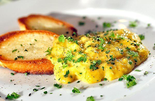 Creamy scrambled eggs with fines herbes.
