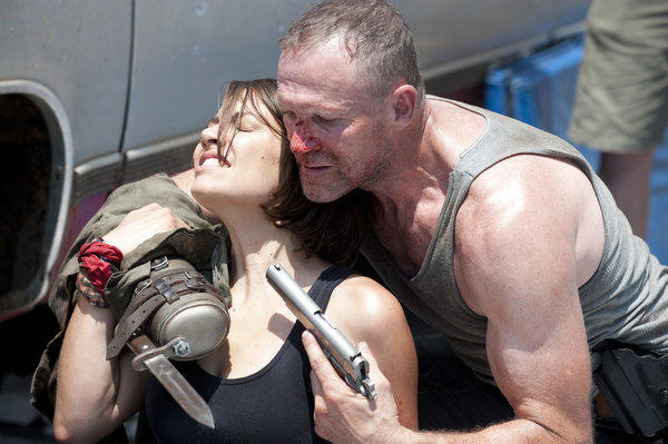 Maggie Greene (Lauren Cohan) and Merle Dixon (Michael Rooker).