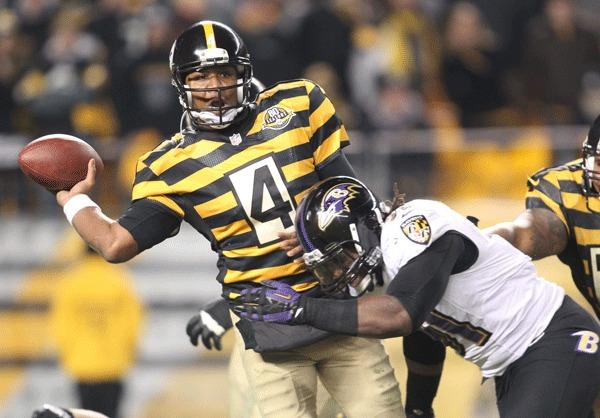 Pittsburgh Steelers quarterback Byron Leftwich (4) passes under pressure from Baltimore Ravens strong safety Bernard Pollard (31) during the fourth quarter at Heinz Field. The Baltimore Ravens won 13-10.