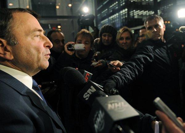 NHL Commissioner Gary Bettman speaks to reporters following labor talks on Nov. 9.