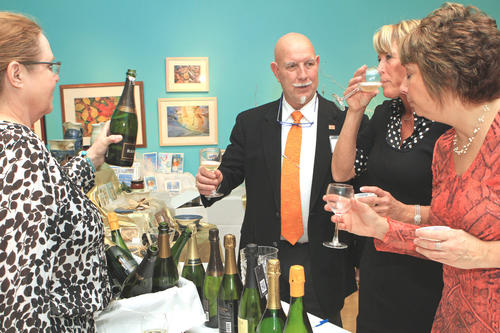The annual Crooked Tree Art Center Holiday Wine Market is well attended Sunday evening with foods and wines by purveyor Glens Fresh Market. Arts and crafts also available for holiday purchase. Proceeds benefit the Crooked Tree Art Center in Petoskey.