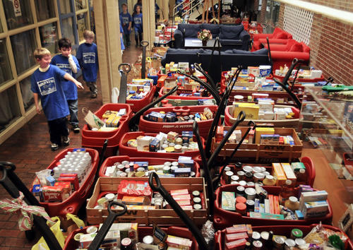 The annual Morley School Red Wagon Food Drive was postponed Tuesday due to rain. The 75 wagons containing almost 5,000 food items to be donated to the West Hartford food pantry will be stored in the school's atrium until after Thanksgiving when they will attempt to hold the event again.
