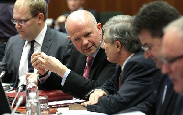 British Foreign Secretary William Hague, second from left, and other participants attend a meeting of European foreign ministers in Brussels.