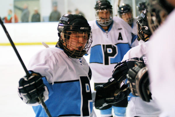 Petoskey senior forward Tanner Davis celebrates his fourth goal of the game in the second period during Friday's season opener against the Mid-Michigan Storm at Griffin Arena. The Northmen defeated the Storm, 9-1.