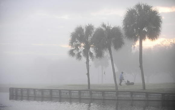 A combination of smog and low clouds blanketed South Florida's eastern areas on Monday.