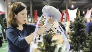 Decorating tree for annual fundraiser adds to Christmas spirit