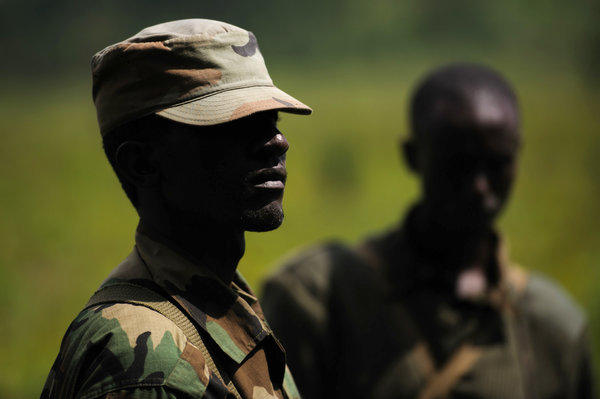 M23 rebels stand at a forward position in the hills of Kanyarucinya on the outskirts of Goma in the eastern Democratic Republic of the Congo on Monday.