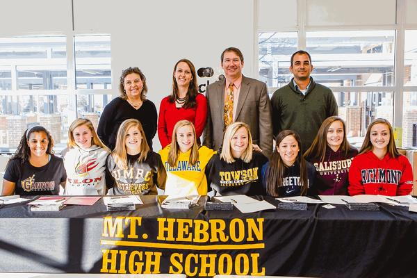 Seated from left: Micky Bowen - Gannon University; Rowan Drake - Elon University; Jessie Czulewicz - University of Maryland, Baltimore County; Jamie Schwartz - University of Delaware; Sam Brookhart - Towson University; Madison Fisher - Georgetown University; Kieran Kelleher - Salisbury University; and Haley Sutton - University of Richmond.
