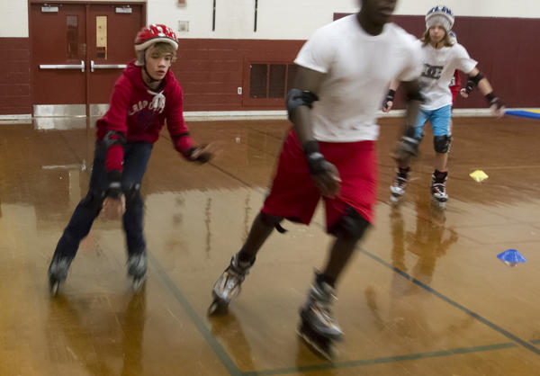 Clayton Frye 14, makes his way around slower moving students Monday during a physical eduction class at Warwick High School. Students learned the basics of safe ways to stop, fall and propel themselves during the morning class.