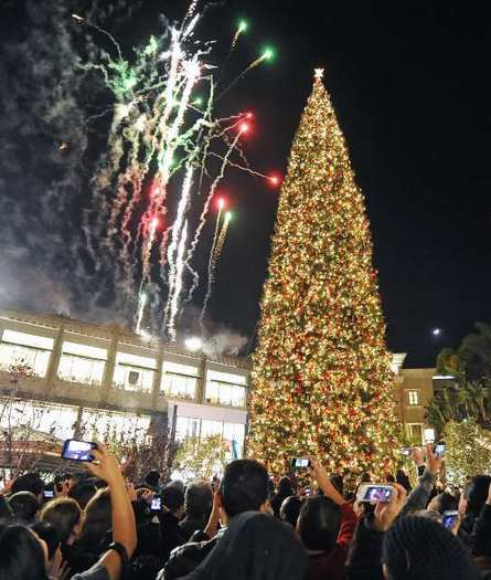 Thousands watch during the annual christmas tree lighting with fireworks and artificial snow at the Americana at Brand on Sunday, Nov. 18, 2012.