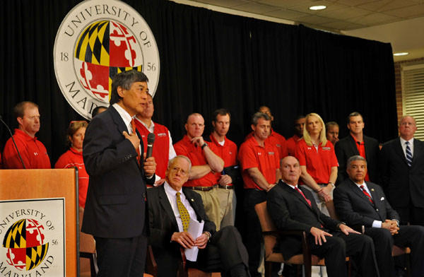 Maryland president Wallace D. Loh speaks during a news conference announcing the university's decision to join the Big Ten. Seated in the front row, from left, are chancellor William 'Brit' Kirwan, Big Ten commissioner Jim Delany and UM athletic director Kevin Anderson.