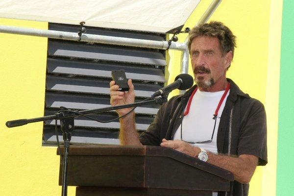 John McAfee speaks at a ceremony at a police station in Ambergris Caye, Belize.
