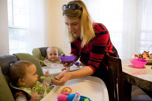 Amy Hobgood feeds her twin daughters Adrienne, left, and Laura at their home outside Boston. Hobgood, 41, had spent eight years trying to become pregnant; the strain on her marriage led to divorce. She turned to Dr. Ernest Zeringue's clinic in Davis, Calif., after she was single, drawn by the price and the prospect of pristine embryos. She and her former husband are now getting back together.