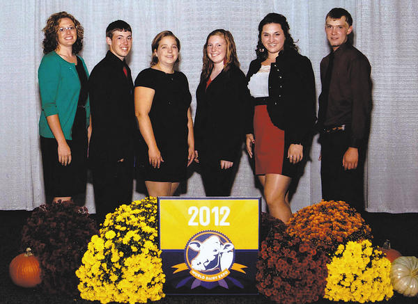 The Maryland 4-H Dairy Judging Team at the World Dairy Expo are, from left, Kiera Finucane, coach; Scott DeBaugh; Jessica Fritz Little, coach; Carol DeBaugh; Tessa Wiles; and Derrick Zimmerman.