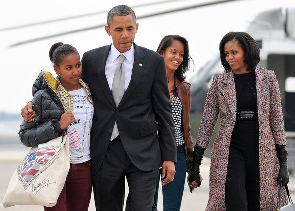President Obama, First Lady Michelle Obama, and their daughters Malia and Sasha, board Air Force One at Chicago O'Hare International Airport in Chicago, Ill.