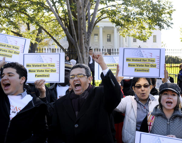 Gustavo Torres, director of Casa in Action, center, called on President Obama to fulfill his promise of passing comprehensive immigration reform during a rally in front of the White House in Washington D.C.