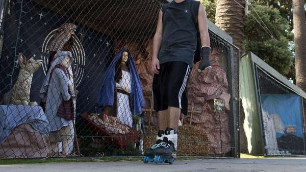 A rollerblader skates by a scene from the Nativity display in Palisades Park along Ocean Avenue in Santa Monica last year.