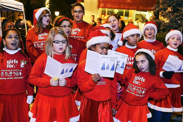Christmas carols were sung by girls from Girls Inc. during the annual tree-lighting ceremony Monday evening in downtown Hagerstown.