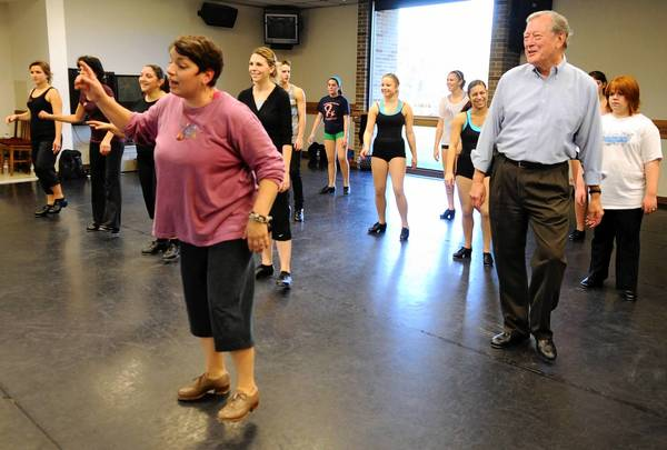 John Seedorff (right) tap dances in Nicole Hockenberry's (left) tap class at the Tap Ties Company's Day of Dance and Friendship at Cedar Crest College.