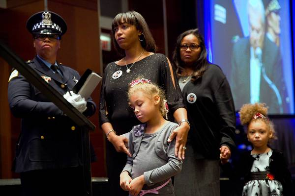 Family members of fallen Chicago police Officer Paul Nauden prepare to receive a posthumous award for him Monday during the department's annual awards ceremony at the Hyatt Regency Chicago downtown hotel. Nauden suffered a heart attack while on duty.