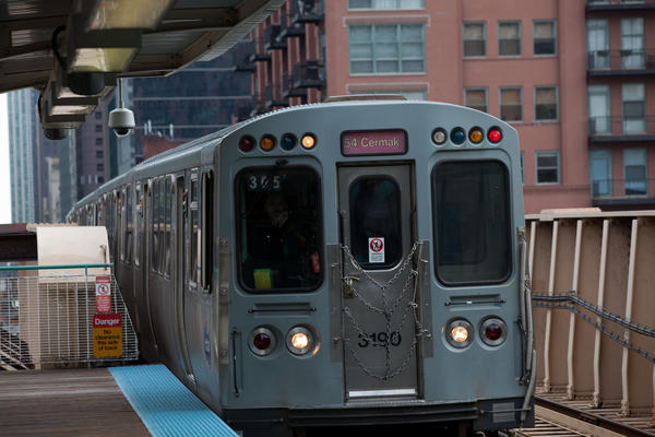 A CTA L train stops at Lake and Clinton Streets in Chicago.