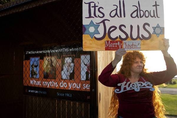 Vikki Hill of Santa Monica protests in front of an atheist group's display in December 2011 where Nativity scenes used to be at Palisades Park along Ocean Avenue.