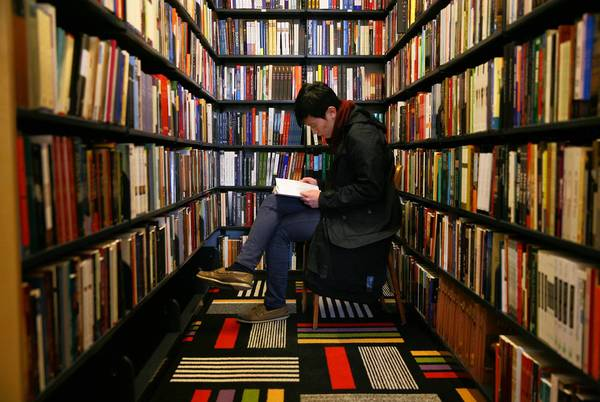 Economics student Jason Kang browses at the Seminary Co-op Bookstore's new location at 5751 S. Woodlawn Ave. The University of Chicago staple officially opens in its new space Wednesday.