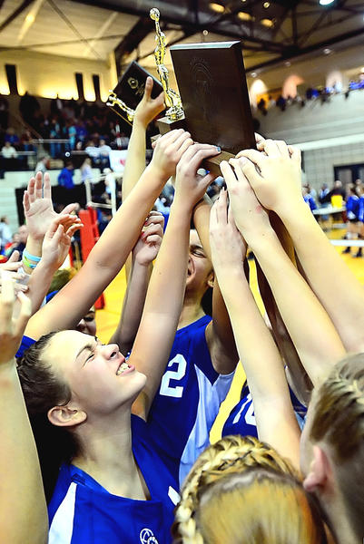 Williamsport's Karli Grimes, bottom left, celebrates with her teammates as they hoist the Maryland Class 2A state championship trophy Monday night in College Park.