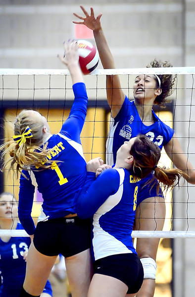 Williamsport's Stacey Christy gets the kill against Calvert's Rachel Hornick (1) and Lauren Carman (8) during the Wildcats' sweep in the Maryland Class 2A volleyball final on Monday.