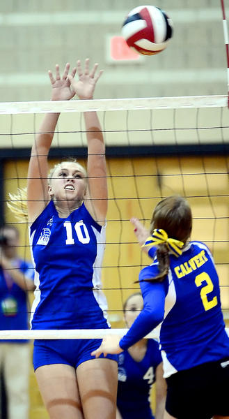 Williamsport's Haley Wolff (10) blocks the shot by Calvert's Kara Wood (2) on Monday night at College Park.