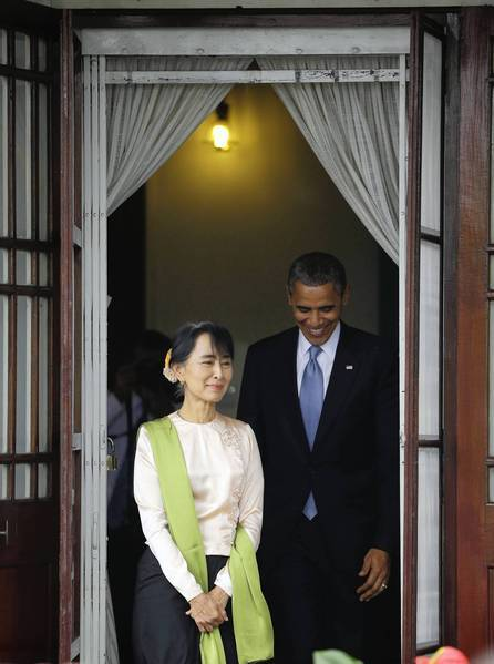 President Obama and Myanmar opposition leader Aung San Suu Kyi prepare to speak to the media at her home in Yangon.