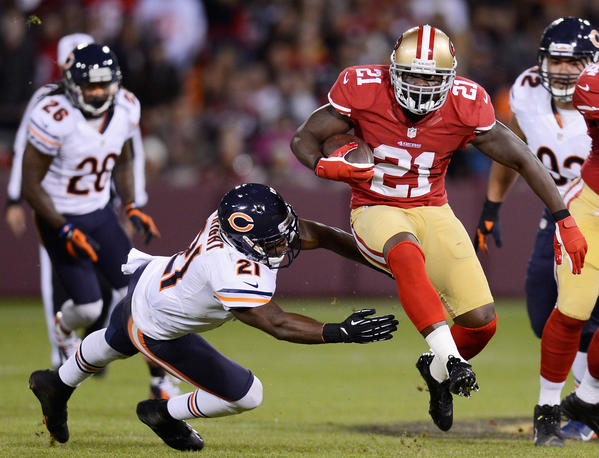 Frank Gore #21 of the San Francisco 49ers carries the ball in the second quarter as Major Wright #21 of the Chicago Bears defends in the second quarter at Candlestick Park on November 19, 2012 in San Francisco, California. San Francisco won 32–7.