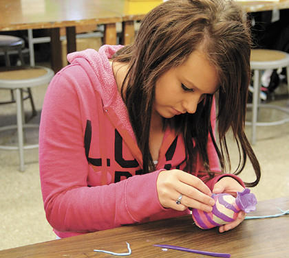 Redfield High School senior Nicole Anderson puts the finishing touches on her Bottle of Hope.