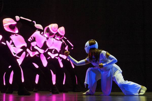 "LaMae Capares as Karate Girl with robots in La Jolla Playhouse's production of ""Yoshimi Battles the Pink Robots."""