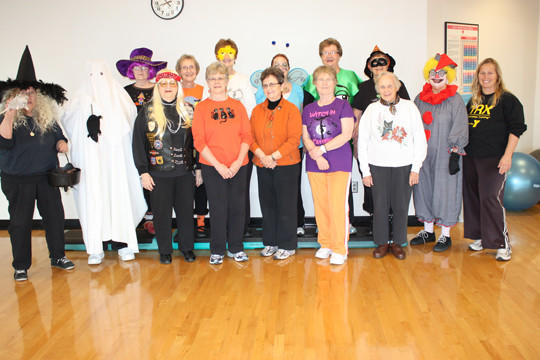 The YMCA Senior Shape Up class recently conducted a Halloween workout. Front row, from left: Emily Buttaro, Arlene Cleberg, Dorothy Merkel, Joan Solberg, LaVerne Tarver, Pat Hermansen and Jeanne Foss. Back row, from left: Dorma Griffin, Elsie Weigel, Corrine Hunstad, Cheryl Merkel, Sally Kusler, Virginia Hoff, Joyce Hermansen and instructor Carol Loeschke.