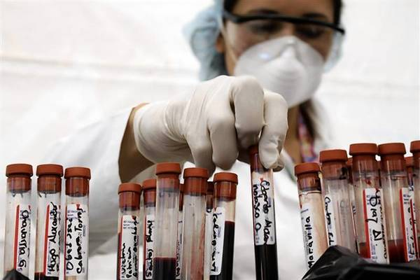 A nurse arranges test tubes containing blood taken during a free HIV test, at an HIV/AIDS awareness rally on World AIDS Day in San Salvador