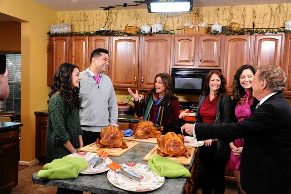 Rachael Ray (center) talks to the Alverado family of Breinigsville during the shooting of a special show titled 'Drect From Your Couch' that will air 10 a.m. Wednesday. From left are Ciara Alverado, Ray Alverado, Rachael Ray, Tina Alverado, Kiana Alverado and Regis Philbin.