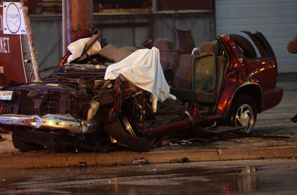 Chicago Police investigate the scene of a fatal crash near the 2400 block of South Damen Avenue in Chicago. One of the vehicle occupants died and two others left without being transported.